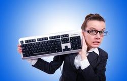与键盘的书呆子商人在 免版税库存照片