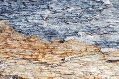 与镇压,石头详细的结构的详细的石表面纹理,蓝色和棕色大理石平板在为后面仿造的自然的 免版税库存图片