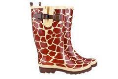与长颈鹿样式的Rainboots 免版税库存照片