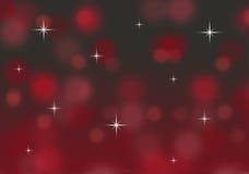 与闪烁星的抽象红色和金bokeh圣诞节背景 免版税库存照片