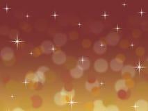 与闪烁星的抽象红色和金bokeh圣诞节背景 库存图片