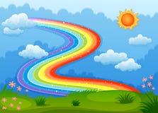 与闪耀的一条彩虹在小山上担任主角 库存照片
