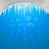 与闪耀的冰柱的冬天背景 免版税库存照片