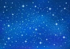 与闪耀的闪烁星的抽象蓝色背景 宇宙发光的星系天空 免版税图库摄影