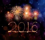 与闪闪发光烟花的新年好2016年 免版税库存照片