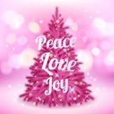 与问候的美丽的桃红色圣诞树 免版税库存照片