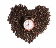 与闹钟的咖啡豆 免版税图库摄影