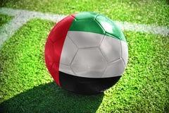 与阿拉伯联合酋长国的国旗的橄榄球球 免版税库存图片