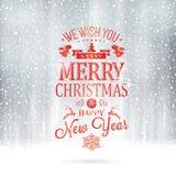 与降雪的红色银色圣诞快乐印刷术卡片 图库摄影