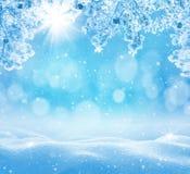 与随风飘飞的雪的冬天背景贺卡的 库存图片