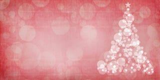 与难看的东西覆盖物的红色圣诞节bokeh圣诞树 免版税库存照片