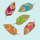 与集合羽毛的手拉的装饰品 库存图片