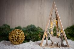 与雪、杉树和xmas光的圣诞节装饰品 免版税库存图片