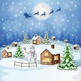 与雪人的冬天风景 免版税图库摄影