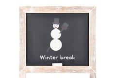与雪人的圣诞节断裂在黑板 皇族释放例证