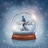 与雪人的雪地球 图库摄影