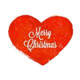 与雪和题字圣诞快乐的红色心脏 免版税库存照片