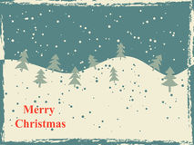 与雪小山和树的减速火箭的圣诞卡 库存图片