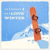 与雪板的减速火箭的冬天风景 免版税库存图片