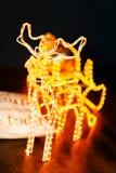 与雪橇的新年发光的驯鹿 图库摄影