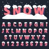 与雪的减速火箭的字体 免版税库存照片