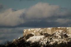 与雪的岩石 免版税图库摄影