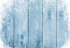 与雪的蓝色木纹理 库存照片