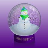与雪的玻璃球形与里面雪人 免版税库存图片