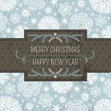 与雪花和labe的蓝色圣诞节背景 库存图片