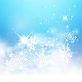 与雪花和Starle的抽象浅兰的冬天背景 库存照片