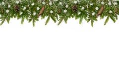 与雪花的圣诞节上部长的装饰 免版税库存图片