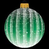 与雪花的圣诞节球在绿色 免版税库存图片