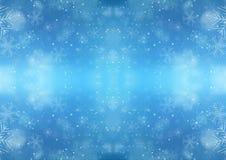 与雪花的圣诞节蓝色背景 库存照片