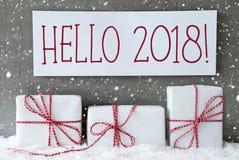 与雪花的白色礼物,文本你好2018年 免版税库存图片