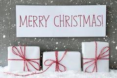 与雪花的白色礼物,文本圣诞快乐 库存图片