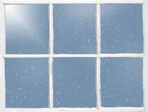 与雪花的老窗玻璃 免版税库存图片