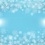 与雪花的蓝色圣诞节背景 免版税库存图片