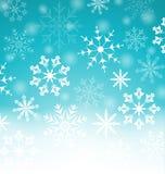 与雪花的Xmas蓝色背景和您的tex的拷贝空间 库存照片