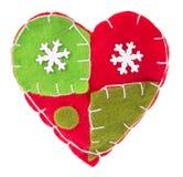 与雪花织品装饰的心脏在树 免版税库存照片