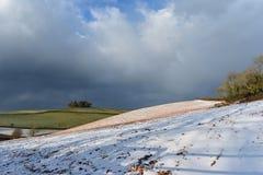 与雪轻的覆盖物的德文郡领域  免版税图库摄影