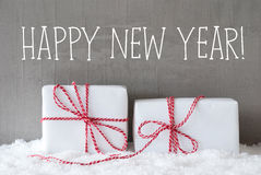 与雪,文本新年快乐的两件礼物 图库摄影