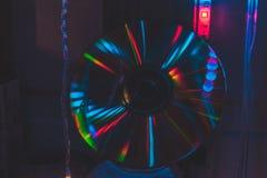 与霓虹灯的CD在黑暗 免版税库存图片