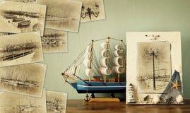 与非常有游艇的小游艇船坞的老图片的马赛克 与减速火箭的作用和老牌照片的拼贴画 船舶概念 库存图片
