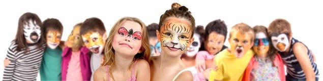 与面孔油漆的孩子 免版税库存照片