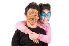 与面孔油漆的孩子 图库摄影