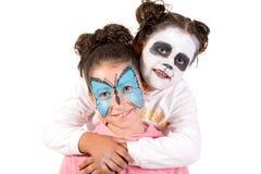 与面孔油漆的孩子 库存图片