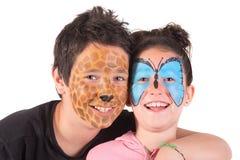 与面孔油漆的孩子 免版税库存图片