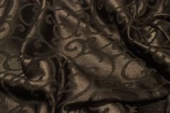 黑暗的织品背景 图库摄影