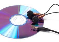与音乐和耳机的CD 免版税库存图片