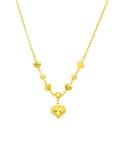 与项链链子的金黄心脏 免版税库存照片